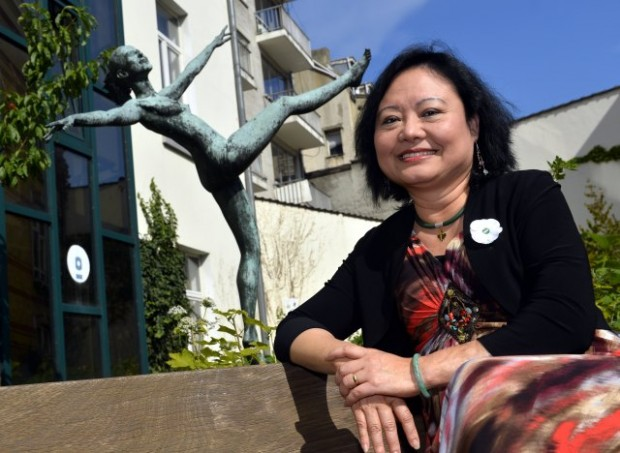 Kim Phuc poses after a meeting of the women's council 'Vrouwenraad' on August 30, 2013 in Brussels. Vrouwenraad invited Vietnamese born Canadian Phan Thi Kim Phuc for a q&a session, she is the girl pictured in an iconic picture taken by photographer Nick Ut during a napalm strike in the Vietnam war. AFP PHOTO/BELGA /ERIC LALMAND        (Photo credit should read ERIC LALMAND/AFP/Getty Images)
