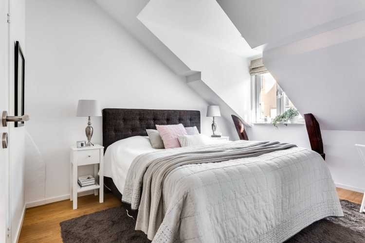 attic-room-with-a-fireplace-in-stockholm-16