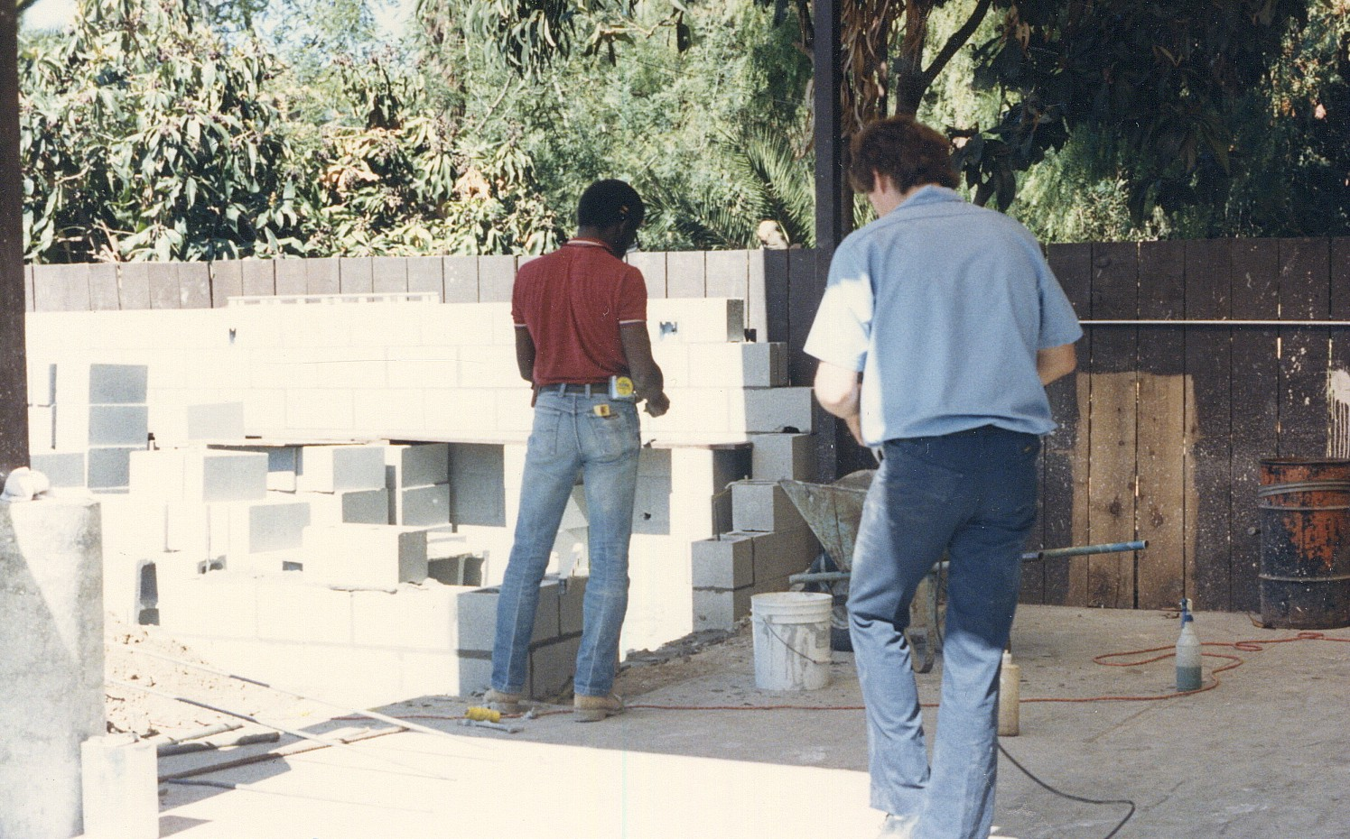 Old photo of two men building the detail shop at Rainbow Carwash Detail Plus in Sunnyvale, California