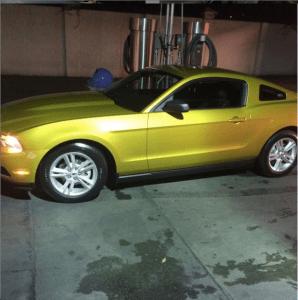 Beautiful gold shiny car at the vacuum station at Rainbow Carwash