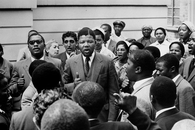Nelson Mandela, center, stands amid a gathering of other co-defendants during the Treason Trial.