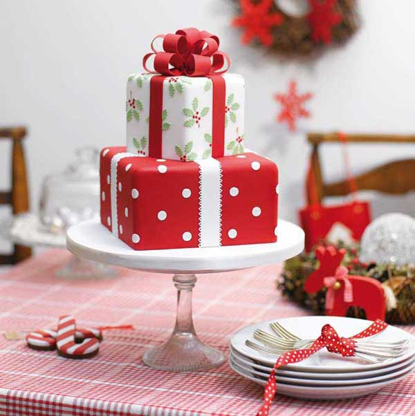 Two layer Christmas cake designed to look like gifts. The cake is creatively made to look like two beautiful Christmas gifts on top of each other, complete with Christmas wrappers and ribbons fit for the occasion.