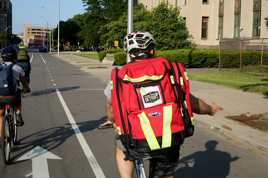 Street Medicine Detroit volunteers ride bikes as part of run to meet patients.