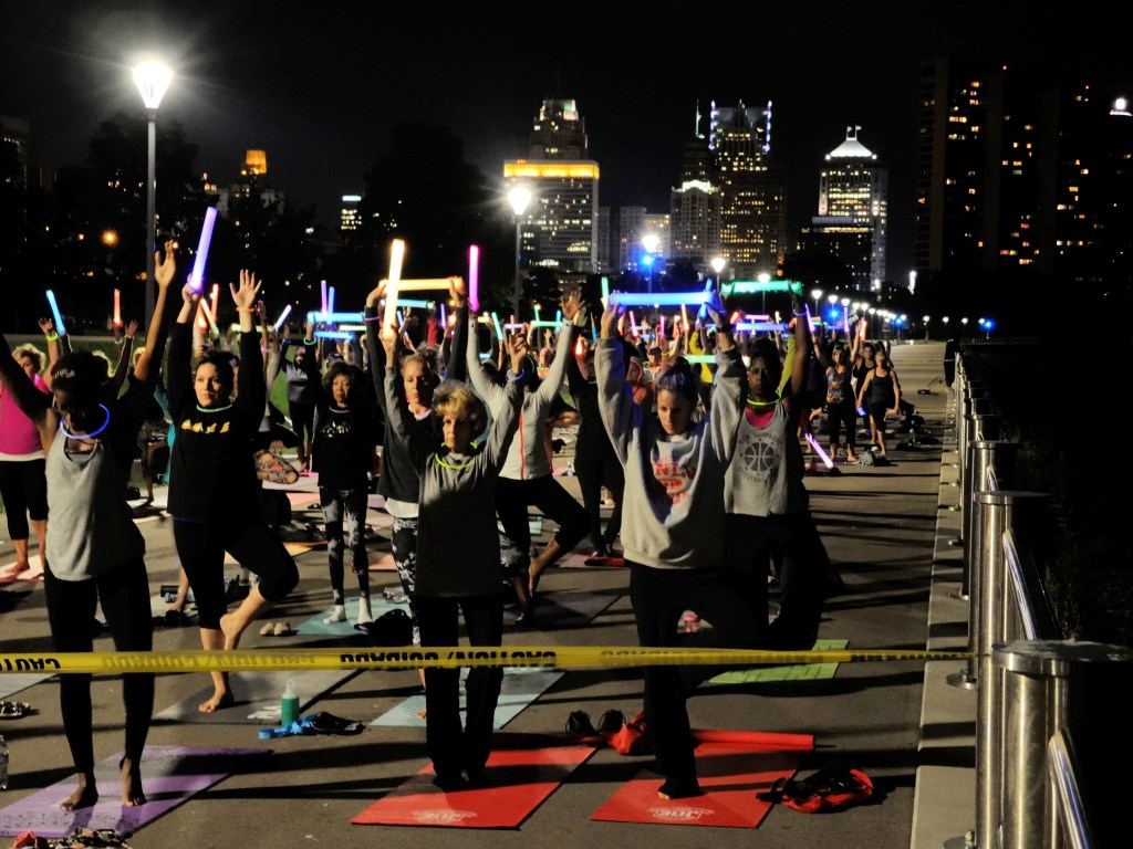 Yoga at night on Detroit's riverwalk. Credit: pverdonk/Flickr