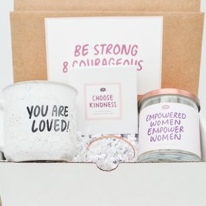 Inkcourage, box featuring a mug, candle, and bracelet, all with empowering messages on each product