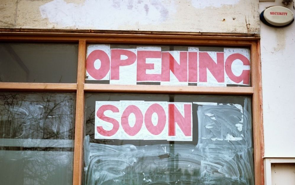 opening soon sign on a business