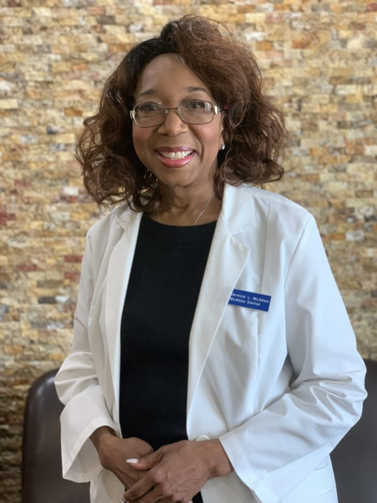 dr. jernice mcadoo purifoy, standing in her white coat