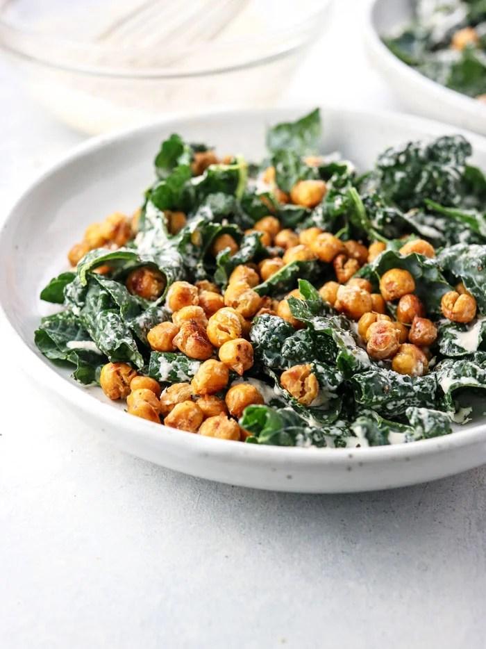 bowl of vegan kale salad with garlic roasted chickpeas