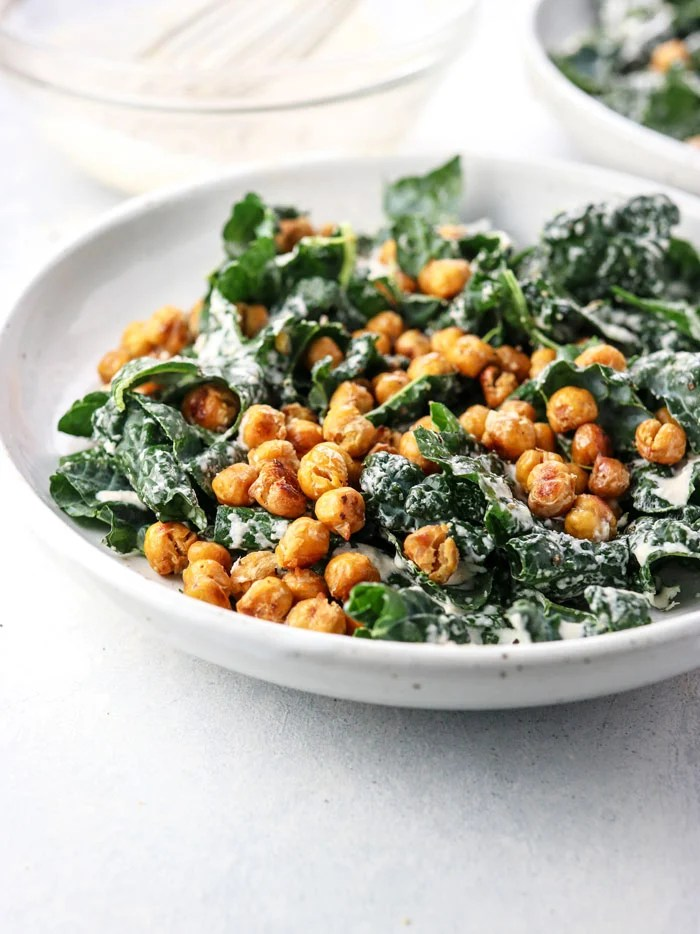 bowl of vegan kale salad with garlic roasted chickpeas