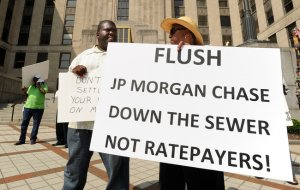 A protest of potential sewer rate increases in Jefferson County, Ala. One sign took aim at JPMorgan Chase, an adviser to the county on a bond deal.