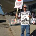 Protesters demonstrate as EM Kevyn Orr meets with Detroit creditors