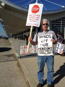 Moratorium Now Coalition member and retired Detroit Water Department worker David Sole, 65, of Detroit protests outside Detroit Emergency Manager Kevyn Orr's meeting with creditors at Metro Airport. / Tammy Stables Battaglia/Detroit Free Press