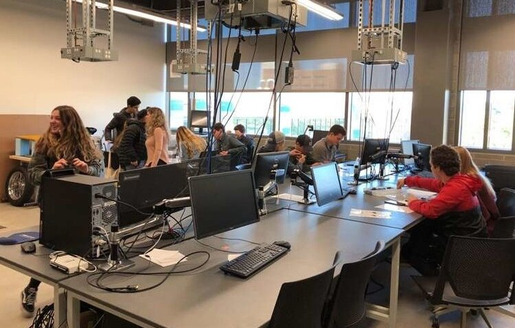 Seaholm High School students participate in an externship at Oakland University's Industrial and Systems Engineering Department, partnering with the Pawley Lean Institute.