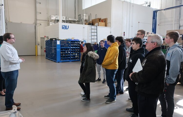 Students tour IAV Automotive Engineering in Auburn Hills on a Discover Auto tour.