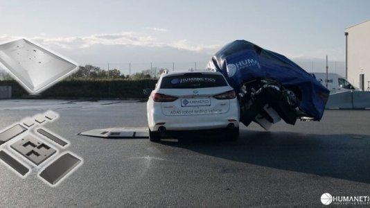 A car crashes into Humanetics' UFO dummy car.
