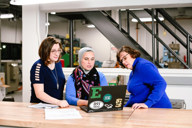Katelyn Coberley, Bia Hamed, and Paulette Avolio work at Eastern Michigan University's Sill Hall.