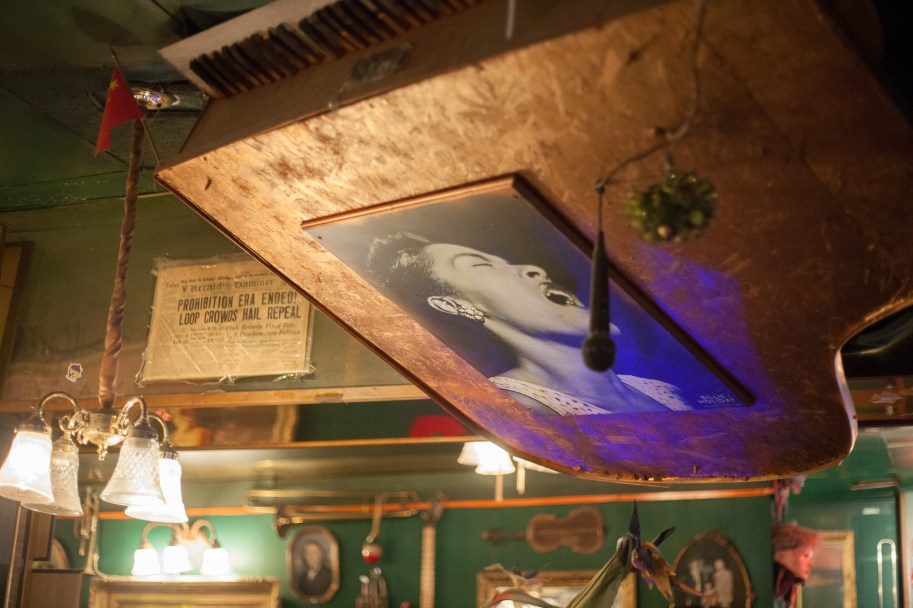 The decor of Cafe d'Mongo's is not traditional. Pianos hover over patrons on the ceiling, old news clippings adorn the walls, and trinkets are just about everywhere. Photo by Stephanie Hume