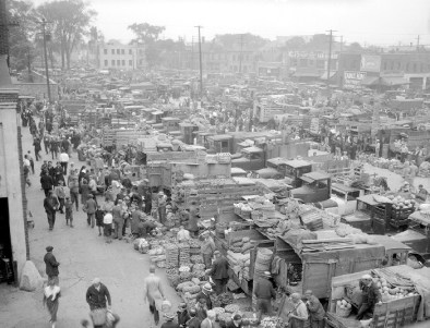 Eastern Market, 1937. Shoppers select produce from vendors at Detroit's Eastern Market, Walter P. Reuther Library, Archives of Labor and Urban Affairs, Wayne State University.