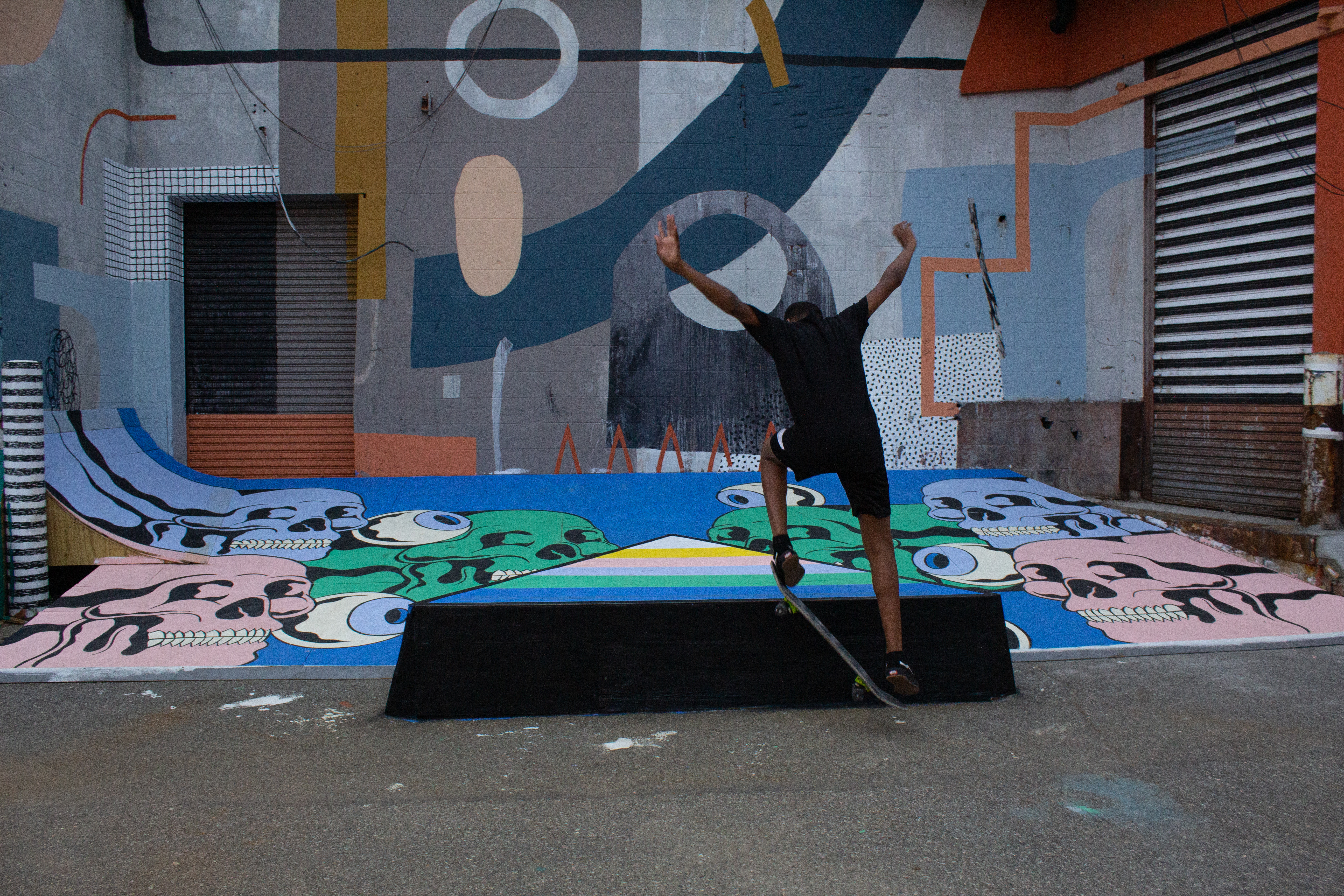 skate park A younger skater lands a flip in front of a mural in the Skate Alley.