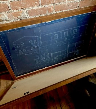 BLUEPRINTS OF THE CHURCH ON ROSA PARKS AVE. PHOTO AMI NICOLE / ACRONYM