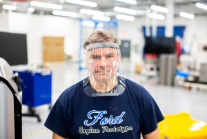 RESPIRATORS DAVE JACEK, 3D PRINTING TECHNICAL, WEARS A PROTOTYPE OF A 3D-PRINTED MEDICAL FACE SHIELD PRINTED AT FORD'S ADVANCED MANUFACTURING CENTER. PHOTO FORD MOTOR COMPANY