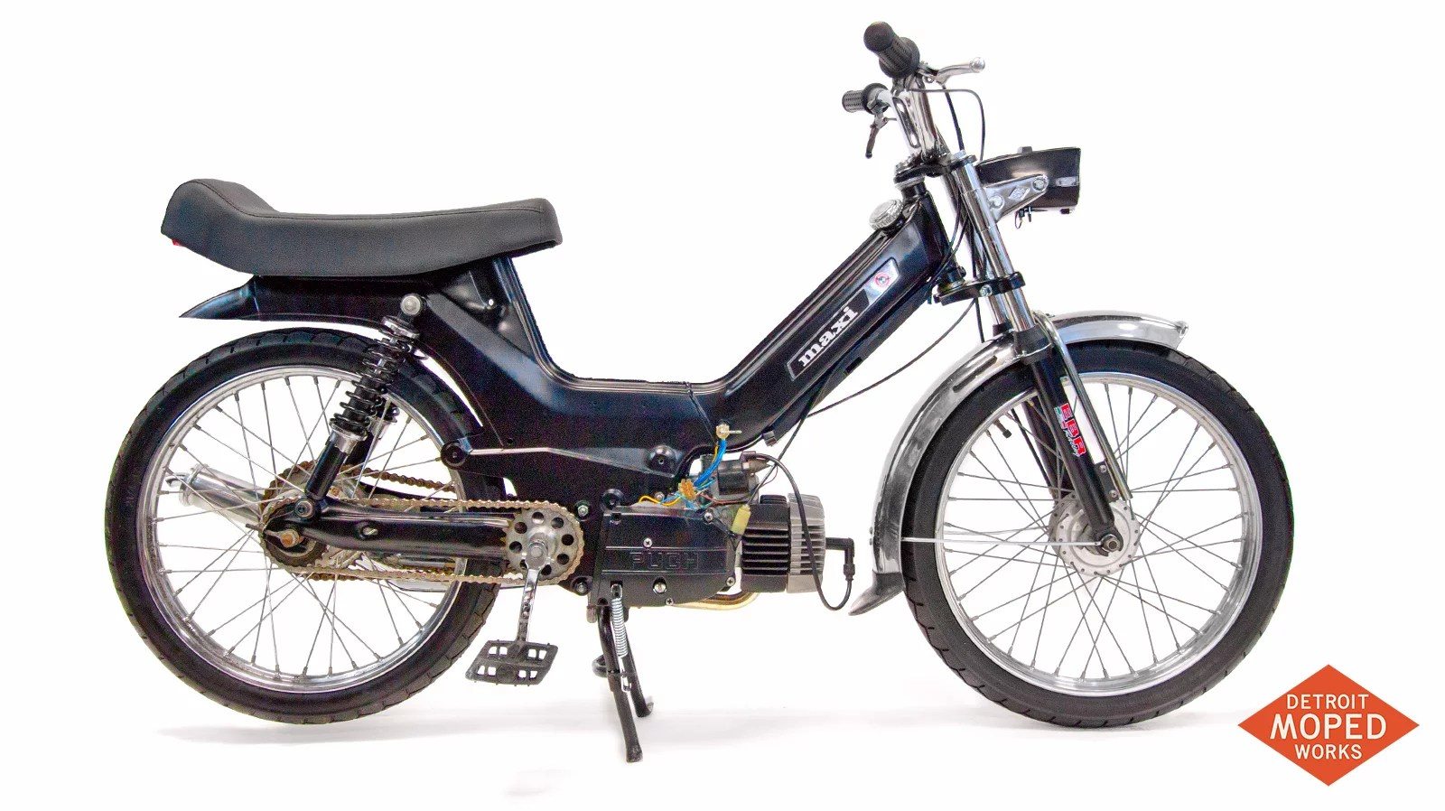 Custom black Puch Maxi E50 with long seat from Detroit Moped Works