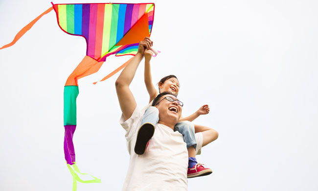 Father and daughter with kite photo from Shutterstock