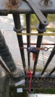 5: Using hydraulic jack to gently push top rail off pickets.