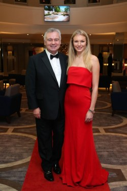 Eamon Holmes arrives at the Neighbourhood Retailer Awards 2015, pictured with model Ella Killen