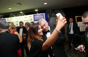 Last years host Eamonn Homles takes a selfie at the 2015 Neighbourhood Retailer Awards