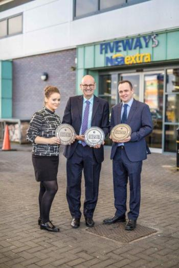 the management team, including Frank Hagan (centre) with their trio of awards