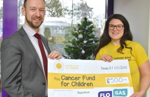 Paul Ruegg, senior marketing executive, Flogas NI, presents a £500 cheque to Sorcha MacLaimhin corporate fundraiser for Cancer Fund for Children at their offices in Belfast