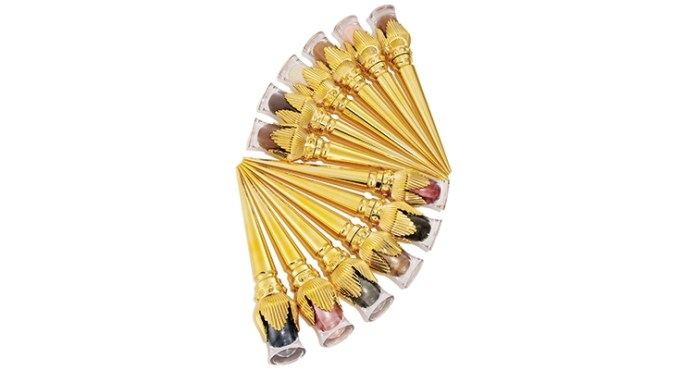 Christian Louboutin's Tape à l'Oeil (eye-catching) Eye Colour collection features clear vials adorned with gold fluted shells that reference Byzantine and Art Déco motifs.