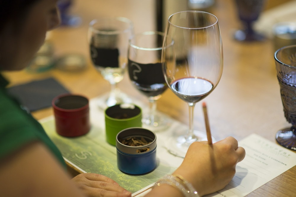 Woman taking notes while participating in an Aromatherapy Interactive Wine Experience at St. Supéry Winery