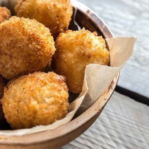 St. Supéry Pancetta and Onion Croquettes on wooden table served in basket