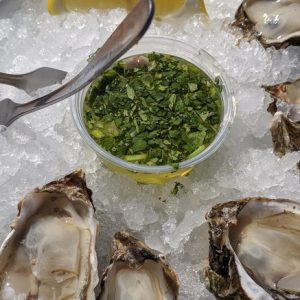 Half Dozen Raw Oysters Served on a Platter. pair with st. supery sauvignon blanc