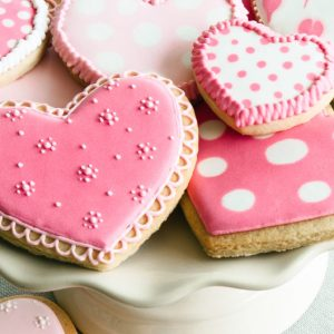 Cake stand filled with Pink Heart Shaped Valentine Cookies