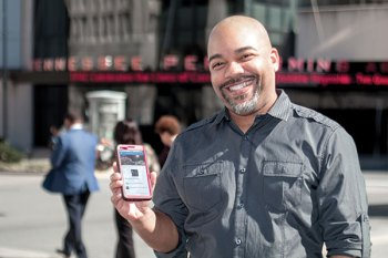 Man holding phone with TPAC Concierge App displayed