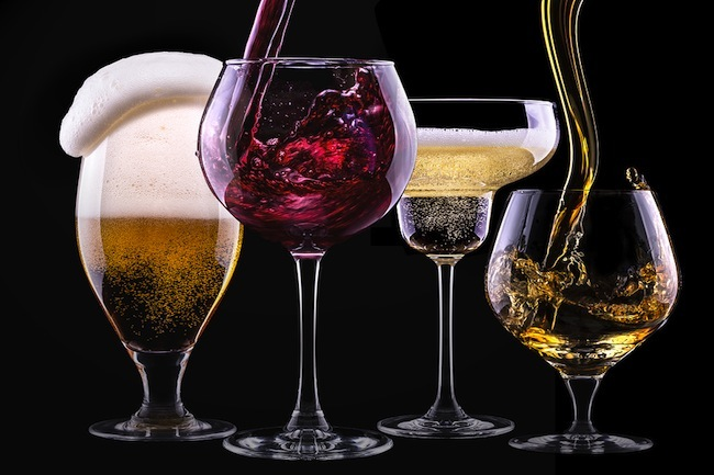 alcohol drinks set isolated on a black background - beer,wine,champagne,scotch