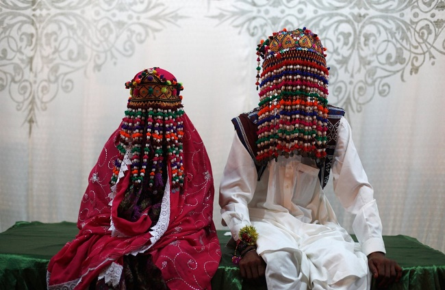 Pakistani pride in traditional wedding dress