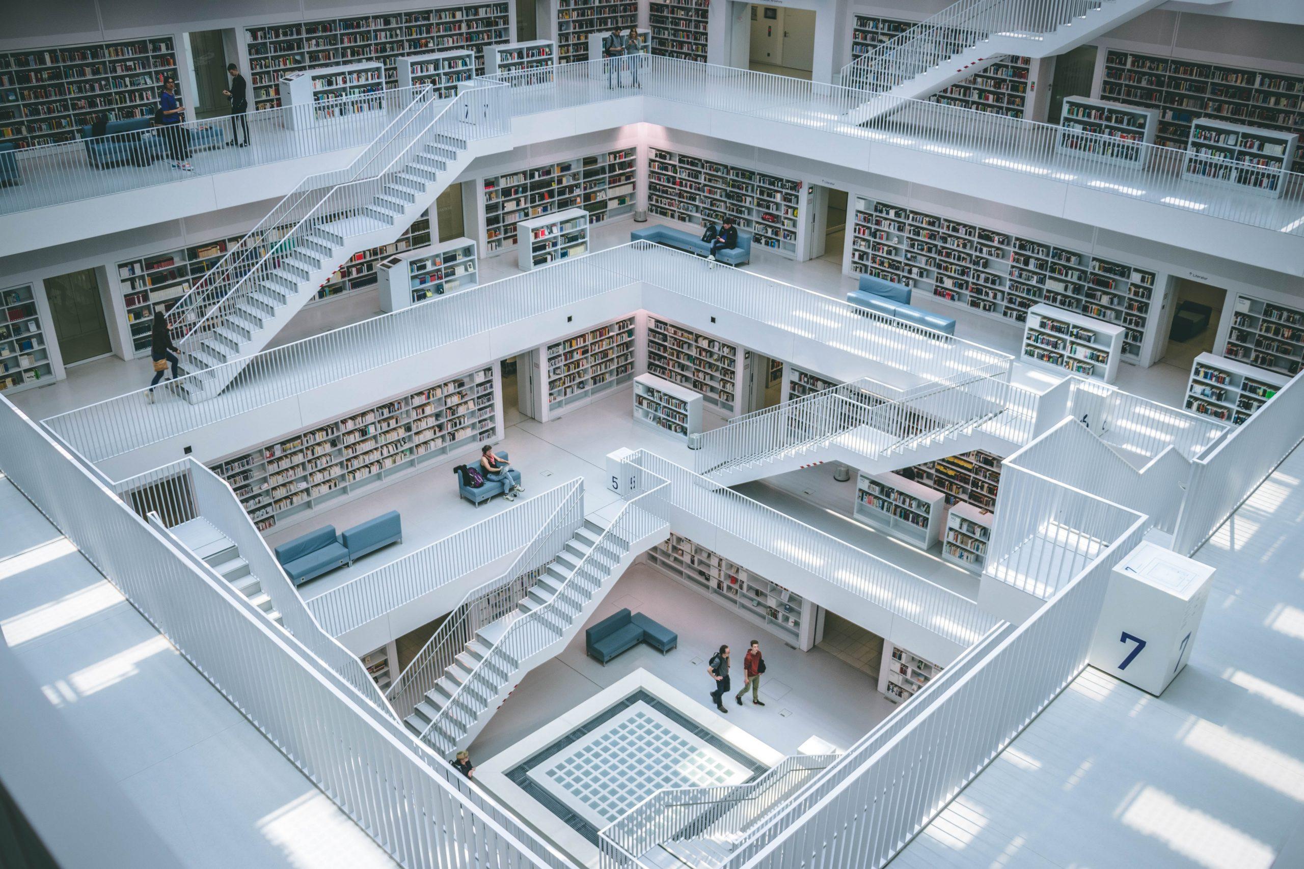 people walking inside library