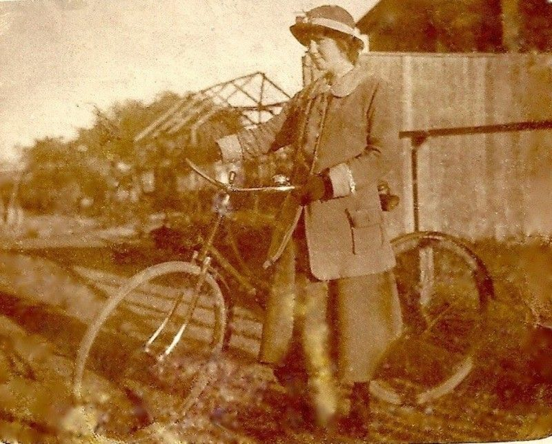 Queenie 1917 with bike setting off for work