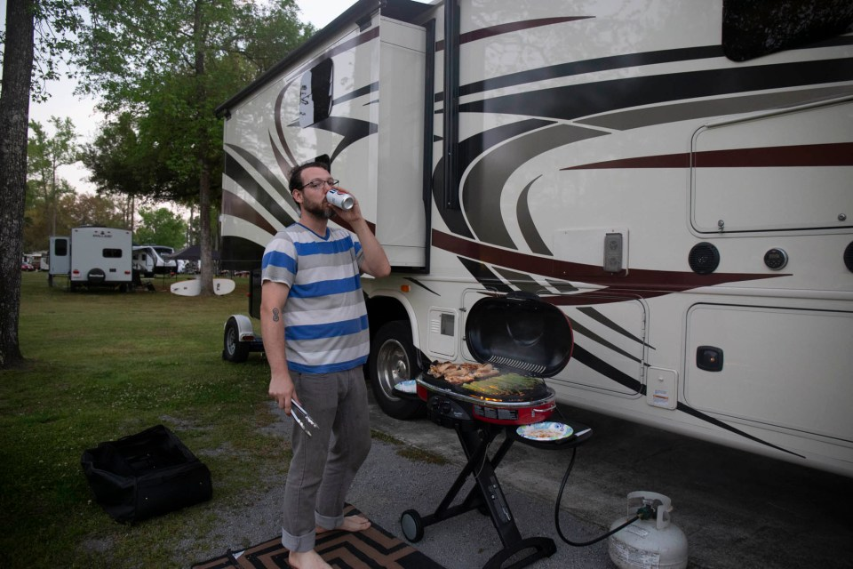 Deven drinking beer and RVing
