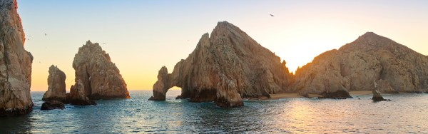 Sunset at Land's End rock formation in Cabo San Lucas, Mexico