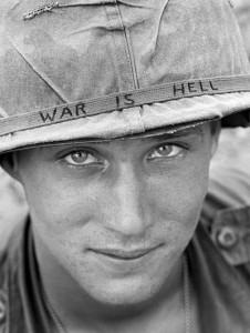 American soldier wears a hand-lettered slogan on his helmet
