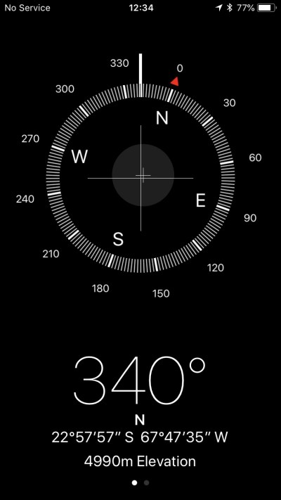Screenshot of the iPhone Compass app, showing an altitude of 4990 metres.