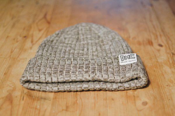 Heather stone brown toque with DMC logo tag on the cuff