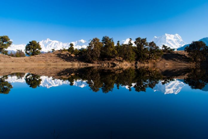 Magical Reflections in Deoriatal Lake