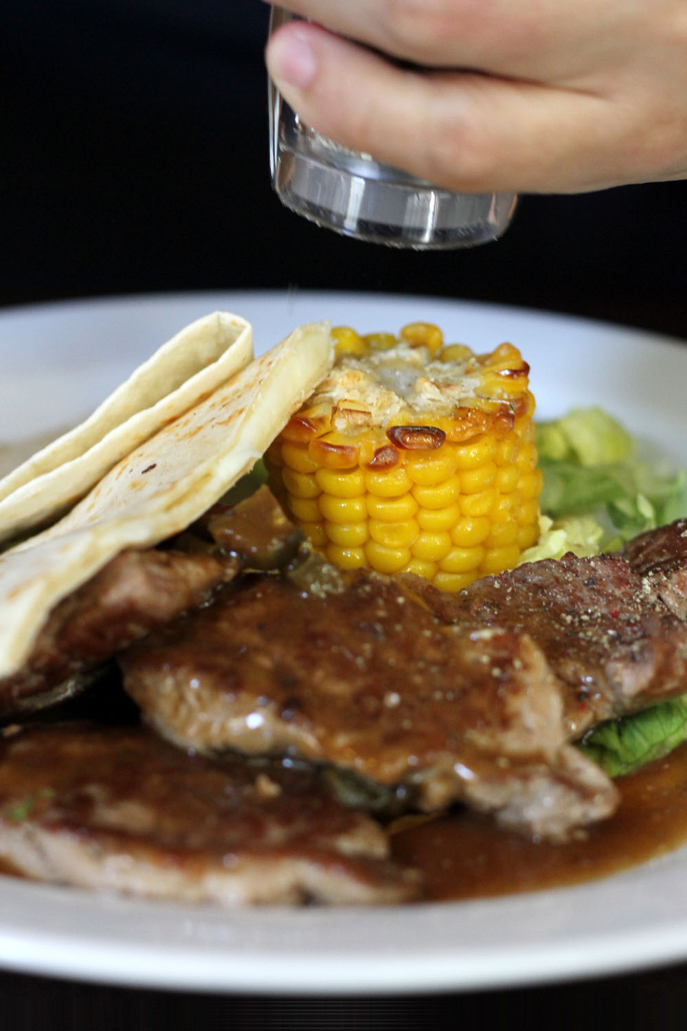 Medallions of pork with jalapenos, grilled corn and cheese quesadillas