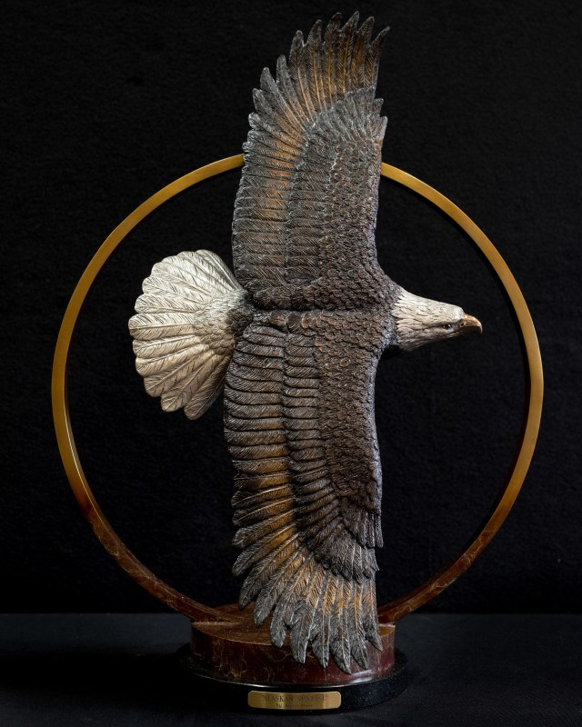 A soaring eagle in the bronze 'Alaskan Sunrise.' (front view)